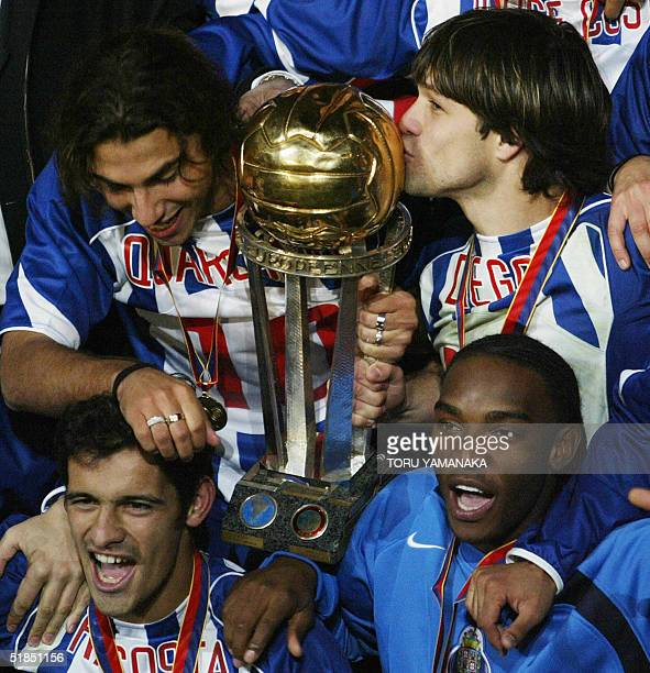 Midfielder Diego of Portugese club FC Porto kisses the Intercontinental Cup as he shares a joy with his teammates Quaresma Ricardo Costa and Benedict...