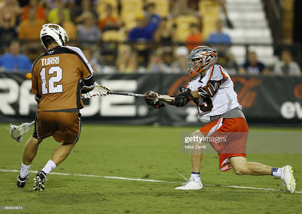 Midfielder Drew Snider #23 of the Denver Outlaws shoots and scores the game winning goal in front of midfielder Justin Turri #12 of the Rochester Rattlers during the 2014 Major League Lacrosse Championship Game at Fifth Third Bank Stadium on August 23, 2014 in Kennesaw, Georgia.