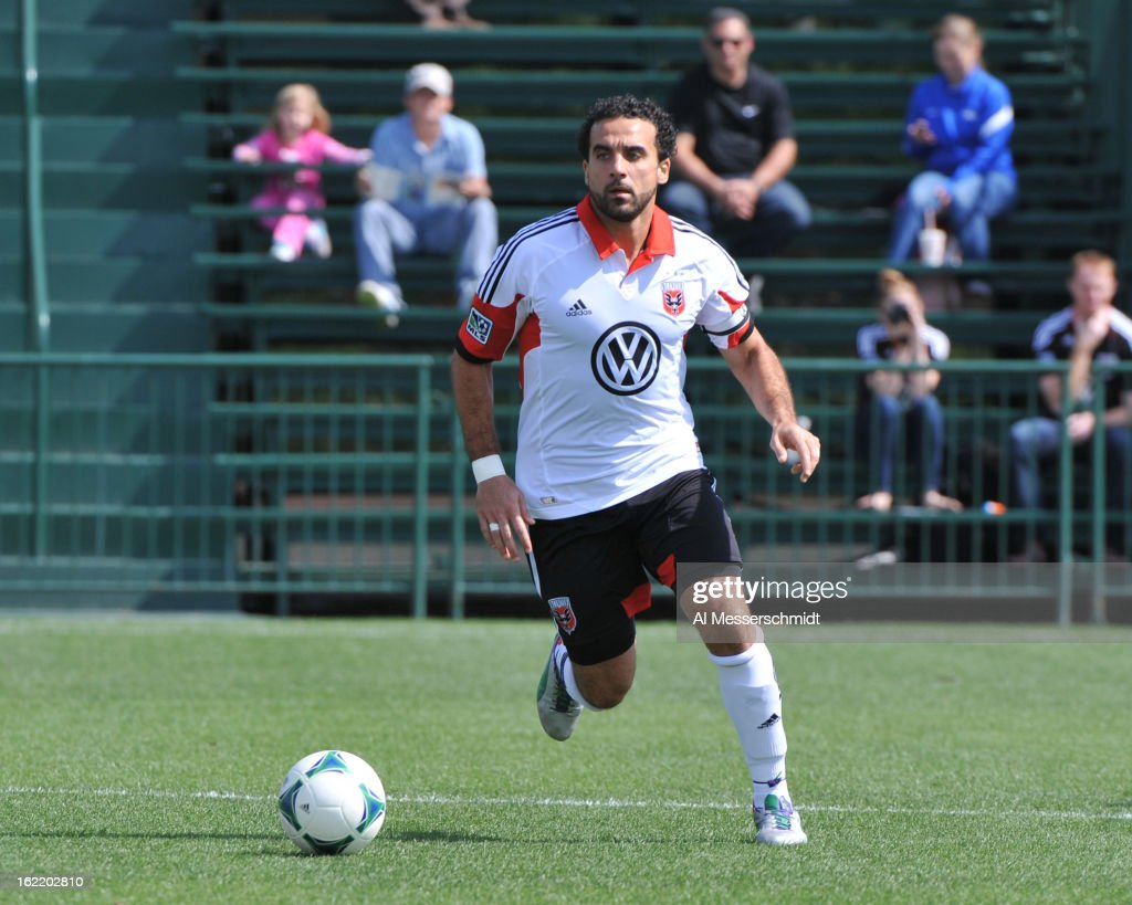 Midfielder <a gi-track='captionPersonalityLinkClicked' href=/galleries/search?phrase=Dwayne+De+Rosario&family=editorial&specificpeople=753516 ng-click='$event.stopPropagation()'>Dwayne De Rosario</a> #7 of DC United runs up field against the Montreal Impact February 16, 2013 in the third round of the Disney Pro Soccer Classic in Orlando, Florida.