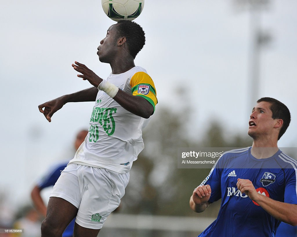 Midfielder Evans Frimpong #20 of the Tampa Bay Rowdies jumps for a ball against the Montreal Impact February 13, 2013 in the second round of the Disney Pro Soccer Classic in Orlando, Florida.