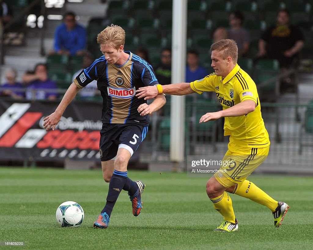 Midfielder Greg Jordan #5 of the Philadelphia Union battles midfielder Konrad Warzycha #19 of the Columbus Crew February 13, 2013 in the second round of the Disney Pro Soccer Classic in Orlando, Florida.