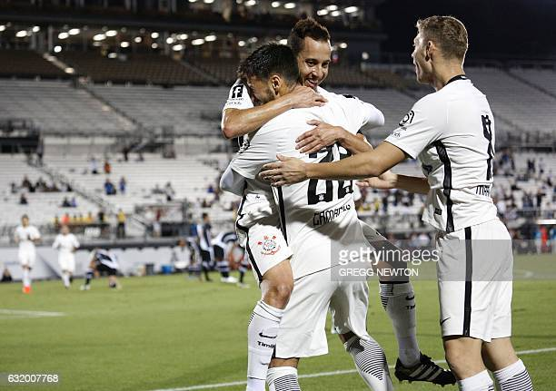 Midfielder Guilherme Camacho of Brazilian club Corinthians celebrates with teammates Rodrigo Marinho and Jonathan Azevedo after scoring a first half...