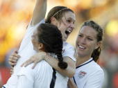 Midfielder Heather O'Reilly of the US Women's National Soccer Team is congratulated by teammates Shannon Boxx and Lauren Cheney after her go ahead...