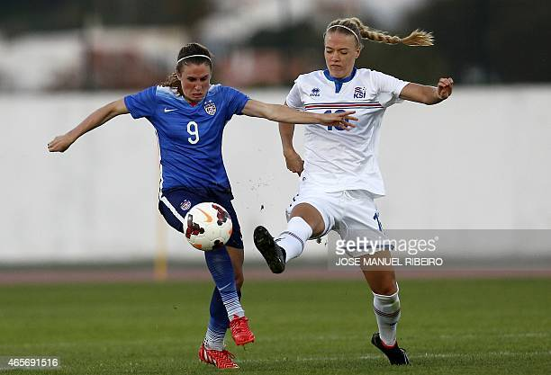 US midfielder Heather OReilly vies with Iceland's midfielder Dagny Brynjarsdottir during the Algarve Cup football match USA vs Iceland at the Estadio...