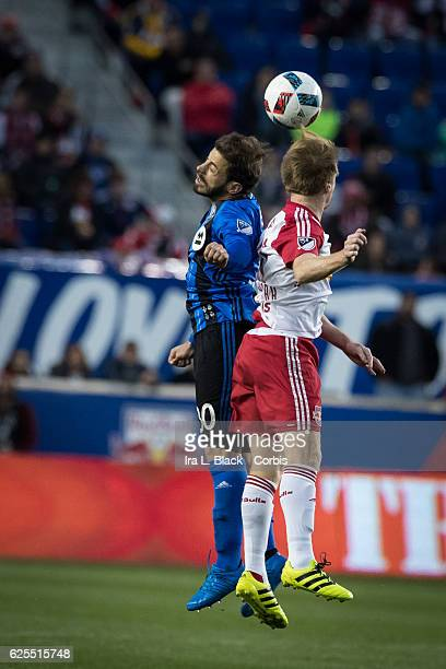 Midfielder Hernán Bernardello of the Montreal Impact goes up for the ball against Captain Dax McCarty of the New York Red Bulls during the second leg...
