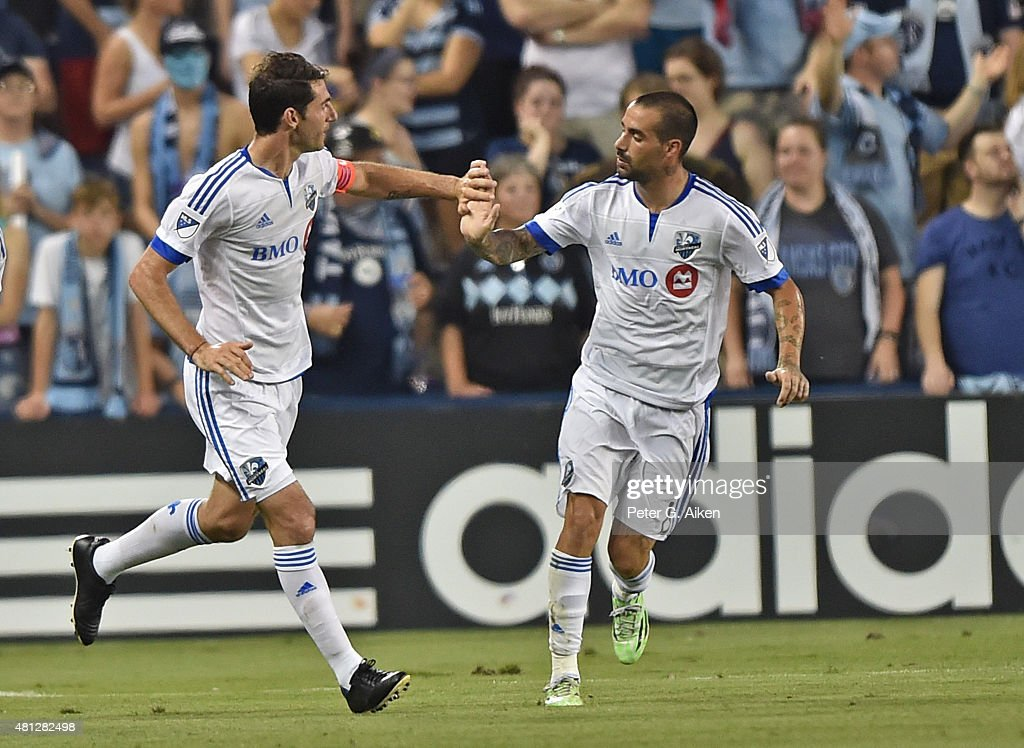 Midfielder Ignacio Piatti of the Montreal Impact celebrates with teammate Andres Romero after scoring against Sporting Kansas City during the second...