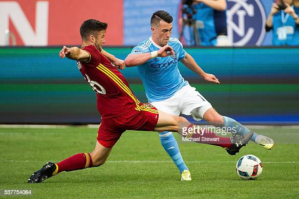 Midfielder Jack Harrison of New York City FC and defender Chris Wingert of Real Salt Lake vie for the ball during the match at Yankee Stadium on June...