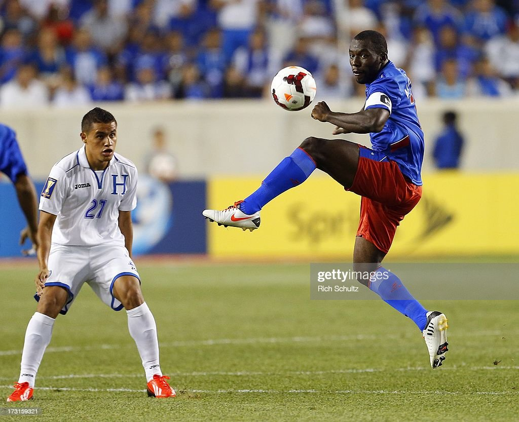 Midfielder Jean-Marc Alexandre #16 of Haiti takes a pass as forward Roger Rojas #21 defends during the first half in a 2013 CONCACAF Gold Cup soccer match on July 8, 2013 at Red Bull Arena in Harrison, New Jersey. Honduras defeated haiti 2-0.