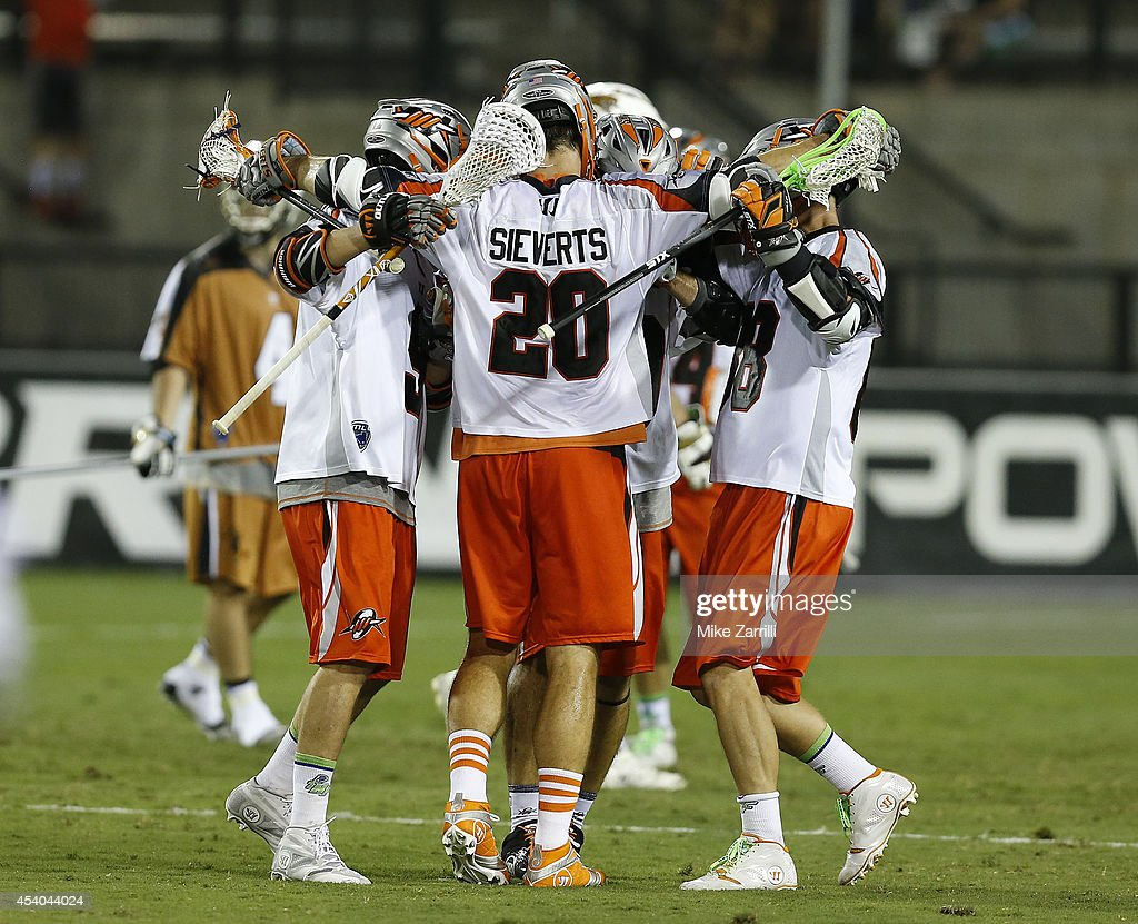 Midfielder Jeremy Sieverts #20 of the Denver Outlaws is congratulated by teammates after scoring during the 2014 Major League Lacrosse Championship Game against the Rochester Rattlers at Fifth Third Bank Stadium on August 23, 2014 in Kennesaw, Georgia.