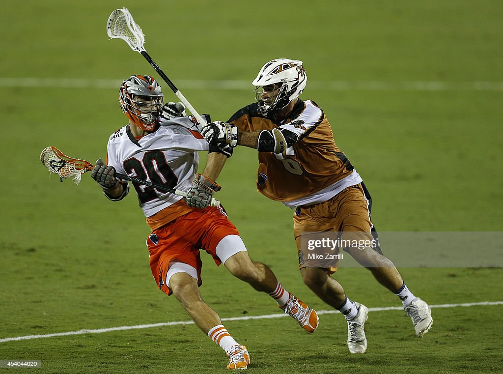 Midfielder Jeremy Sieverts #20 of the Denver Outlaws is harrassed by midfielder Stephen Ianzito #6 of the Rochester Rattlers during the 2014 Major League Lacrosse Championship Game at Fifth Third Bank Stadium on August 23, 2014 in Kennesaw, Georgia.