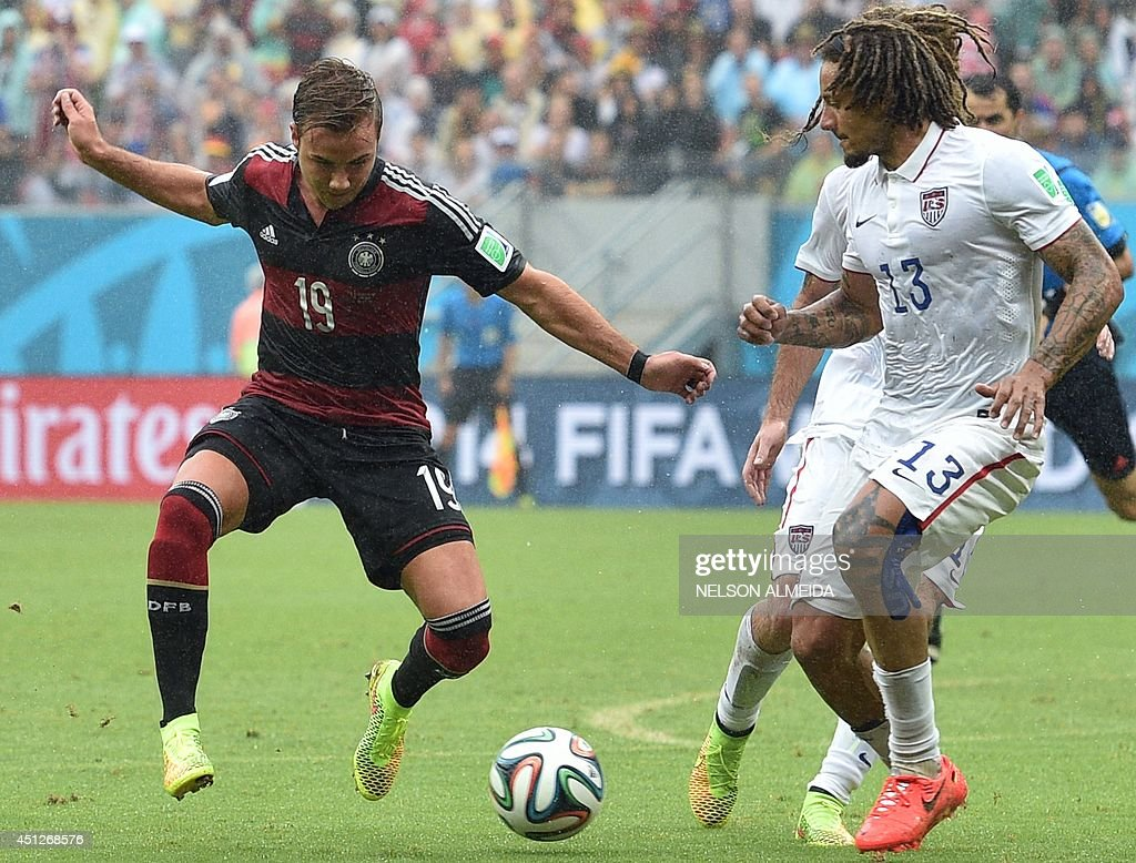 US midfielder <a gi-track='captionPersonalityLinkClicked' href=/galleries/search?phrase=Jermaine+Jones+-+Futebolista&family=editorial&specificpeople=12906336 ng-click='$event.stopPropagation()'>Jermaine Jones</a> (R) and Germany's forward Mario Goetze vie for the ball during a Group G football match between US and Germany at the Pernambuco Arena in Recife during the 2014 FIFA World Cup on June 26, 2014. AFP PHOTO / NELSON ALMEIDA