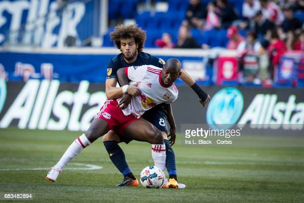 Midfielder Joao Pedro Machado of the LA Galaxy holds back Bradley WrightPhillips of the NY Red Bulls during the MLS match between LA Galaxy vs New...