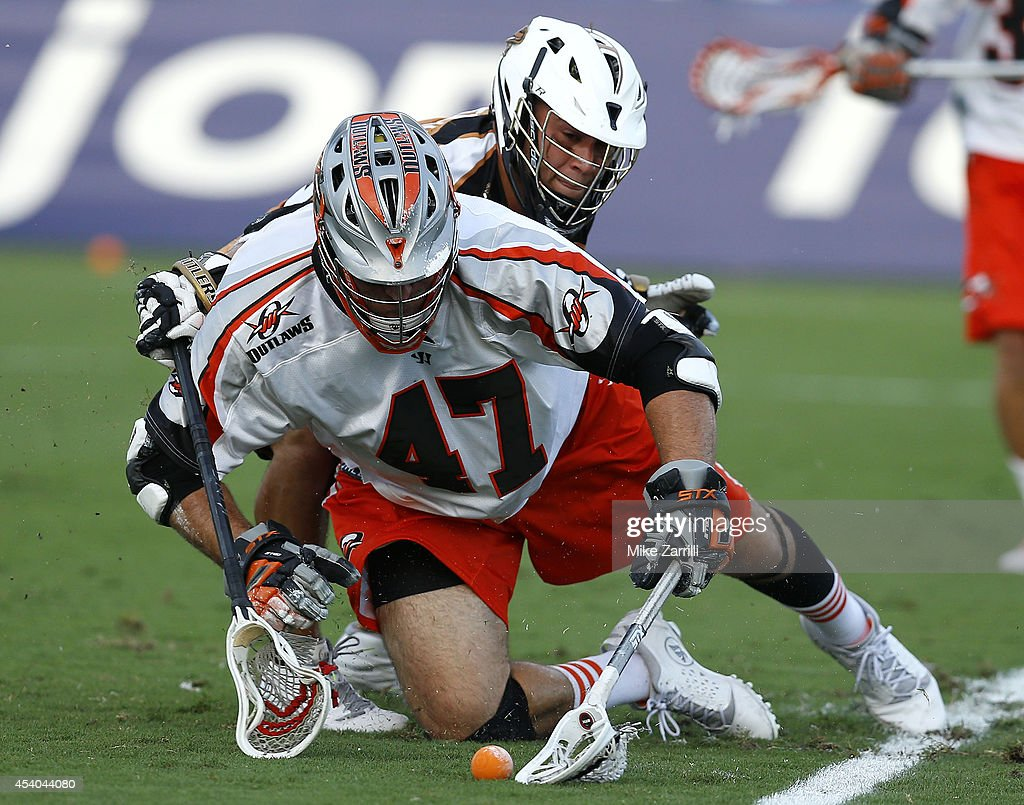 Midfielder John Ortolani #30 of the Rochester Rattlers (B) battles midfielder Anthony Kelly #47 of the Denver Outlaws at midfield during the 2014 Major League Lacrosse Championship Game at Fifth Third Bank Stadium on August 23, 2014 in Kennesaw, Georgia.