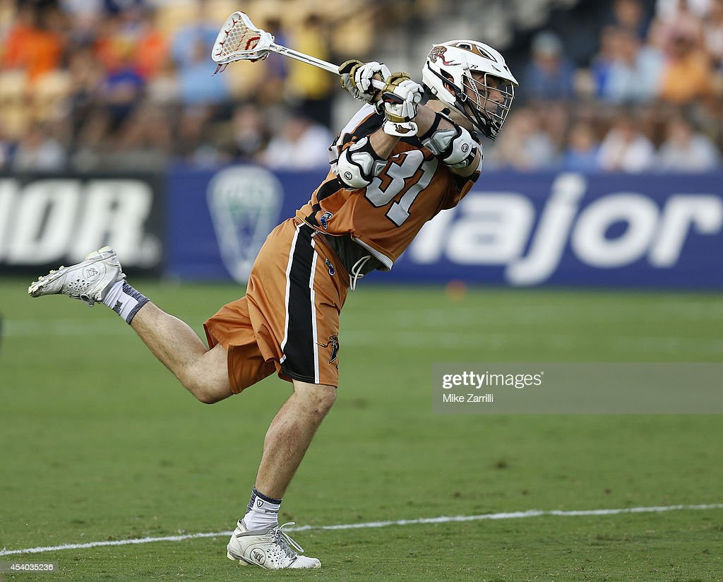 Midfielder John Ranagan #31 of the Denver Outlaws shoots and scores during the 2014 Major League Lacrosse Championship Game against the Rochester Rattlers at Fifth Third Bank Stadium on August 23, 2014 in Kennesaw, Georgia.