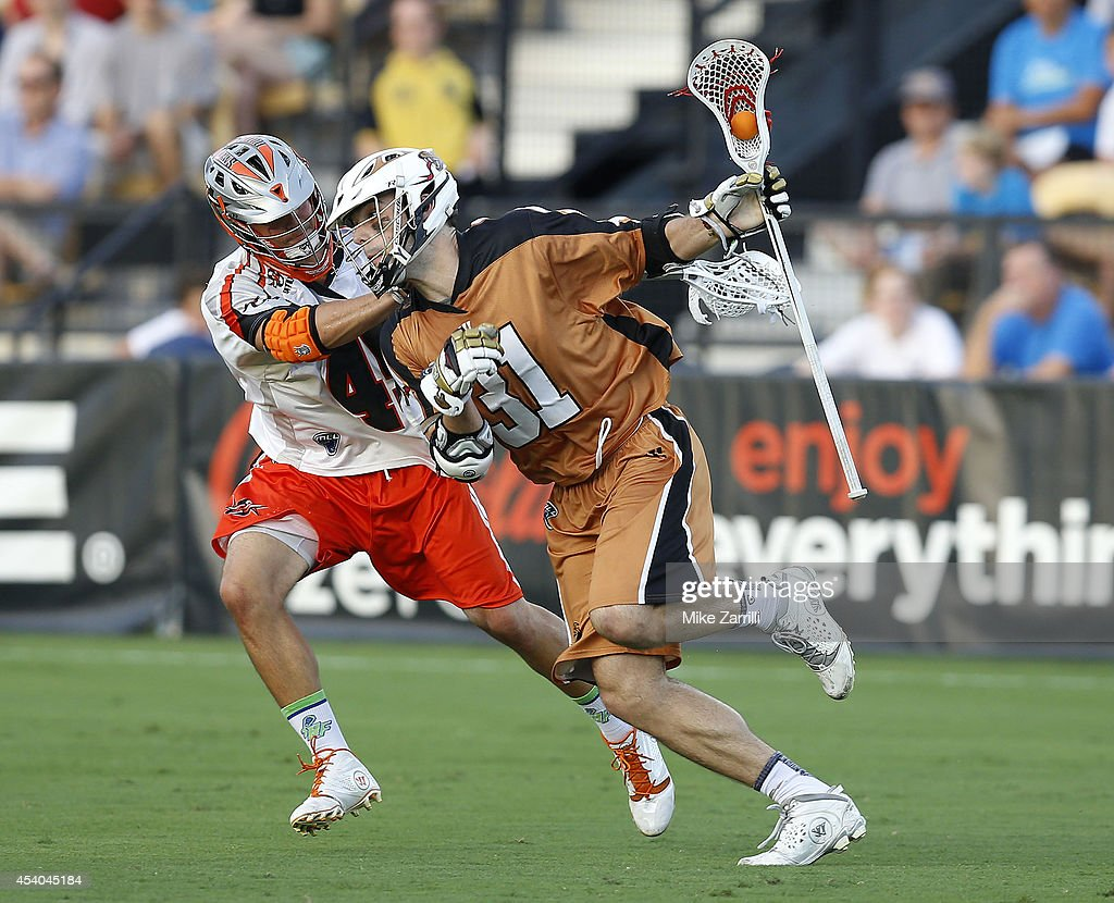 Midfielder John Ranagan #31 of the Rochester Rattlers tries to run past midfielder Anthony Kelly #47 of the Denver Outlaws during the 2014 Major League Lacrosse Championship Game at Fifth Third Bank Stadium on August 23, 2014 in Kennesaw, Georgia.