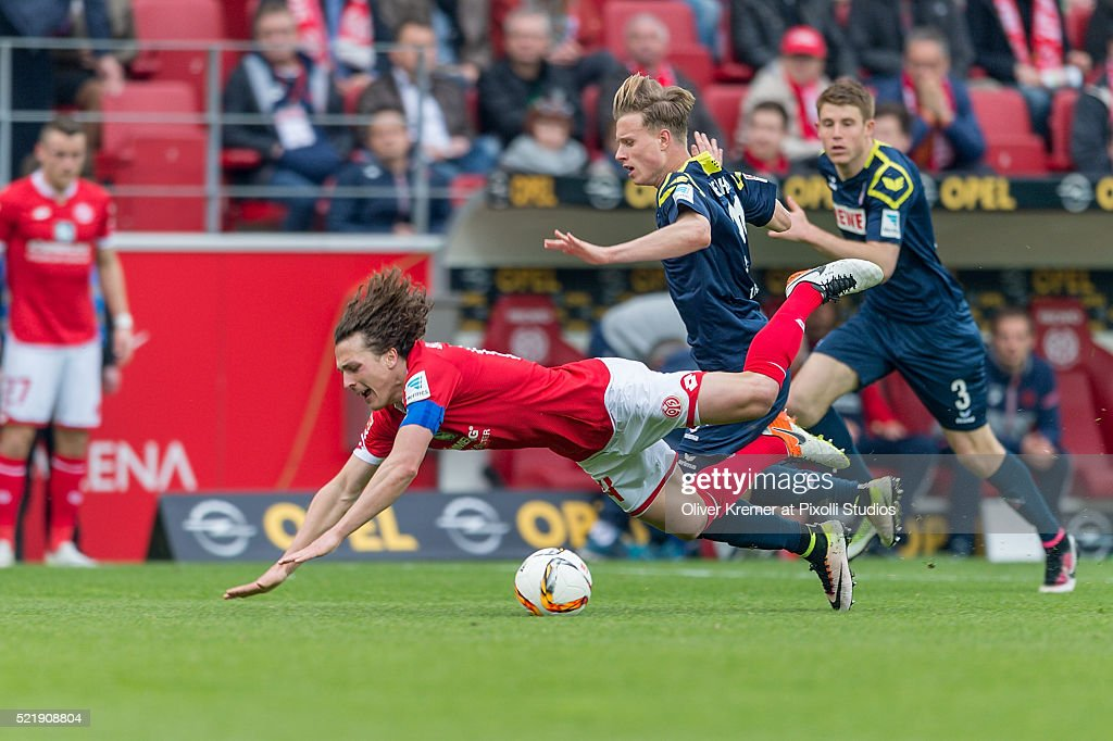 Midfielder <a gi-track='captionPersonalityLinkClicked' href=/galleries/search?phrase=Julian+Baumgartlinger&family=editorial&specificpeople=4228877 ng-click='$event.stopPropagation()'>Julian Baumgartlinger</a> (14) of FSV Mainz 05 fouled by Midfielder Yannick Gerhardt (31) of 1.FC Koeln at Coface Arena during the Bundesliga match between 1. FSV Mainz 05 and 1. FC Koeln on April 17, 2016 in Mainz, Germany.