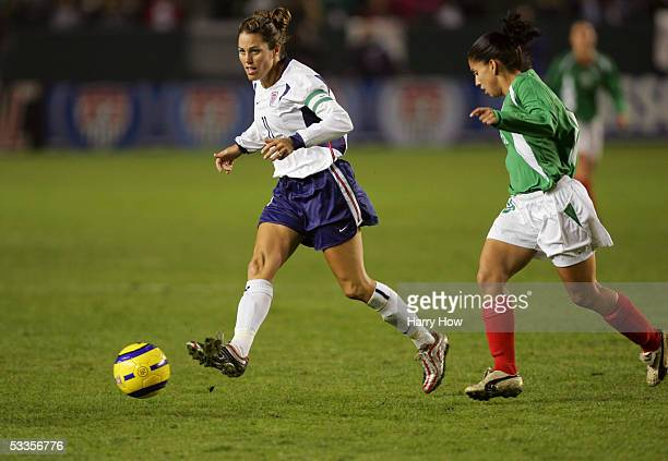 Midfielder Julie Foudy of the USA dribbles the ball during the 'Fan Celebration Tour' finale against Mexico on December 8 2004 at The Home Depot...