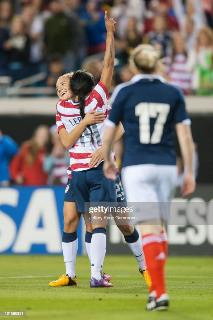 Midfielder Kristie Mewis #23 of the United States embraces Forward Sydney Leroux #14 of the United States after her goal against Scotland during the game at EverBank Field on February 9, 2013 in Jacksonville, Florida.