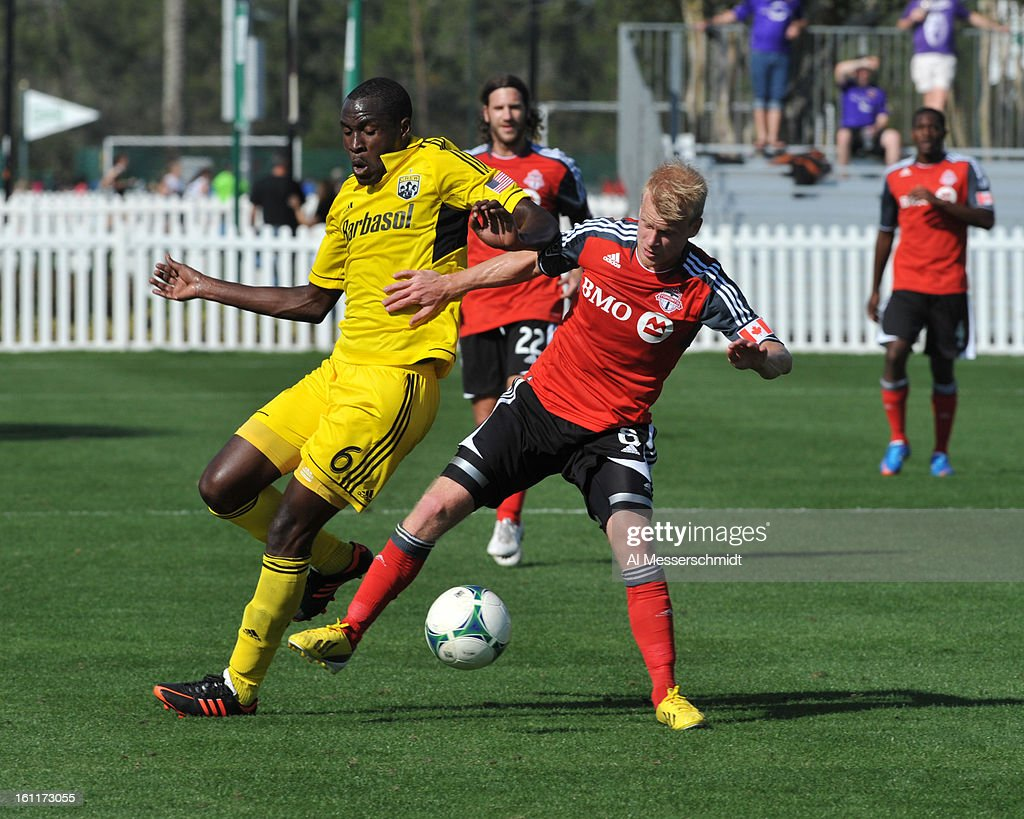 Midfielder Kyle Bekker #8 of Toronto FC battles midfielder Tony Tchani of the Columbus Crew February 9, 2013 in the first round of the Disney Pro Soccer Classic in Orlando, Florida. Columbus won 1 - 0.