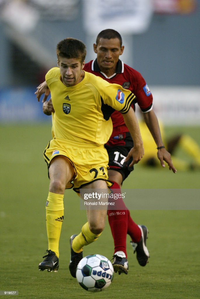 Midfielder Kyle Martino of the Columbus Crew left keeps the ball away from Jorge Rodriguez of the Dallas Burn at the Cotton Bowl in Dallas Texas on...