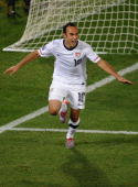 US midfielder Landon Donovan celebrates after scoring during their Group C first round 2010 World Cup football match on June 23 2010 at Loftus...