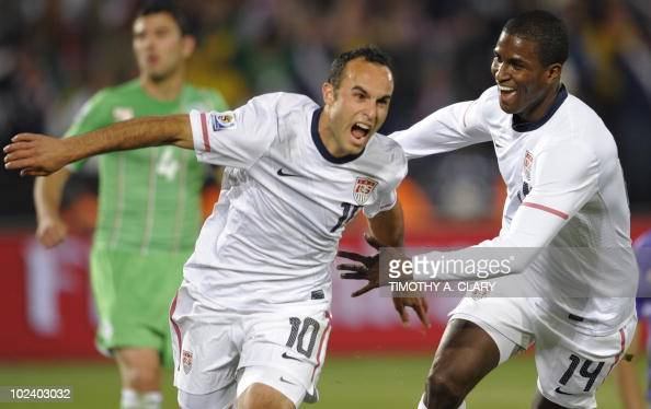 US midfielder Landon Donovan celebrates his goal with teammate striker Edson Buddle during the Group C first round 2010 World Cup football match USA...
