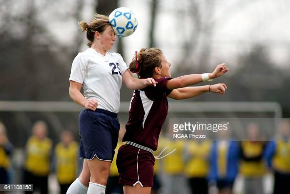 Midfielder Laura Rauh of Wheaton and midfielder Tera Anderson of Puget Sound battle for the ball during the Division III Women's Soccer Championship...