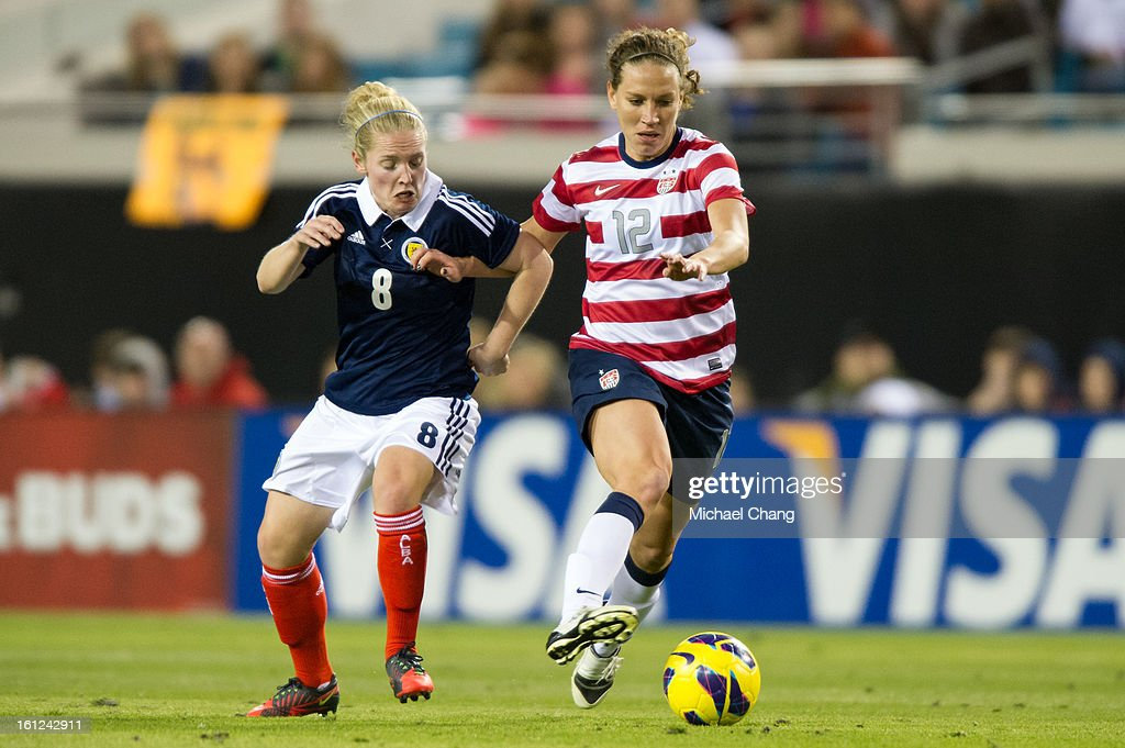 Midfielder Lauren Cheney #12 of the United States and midfielder Kim Little #8 of Scotland battle for the ball at EverBank Field on February 9, 2013 in Jacksonville, Florida. The United States defeated Scotland 4-1.