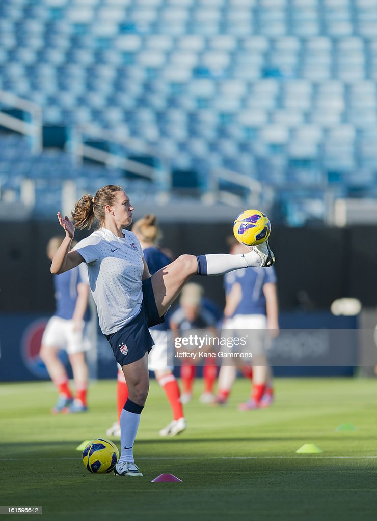 Midfielder Lauren Cheney #12 of the United States warms up before the game against Scotland at EverBank Field on February 9, 2013 in Jacksonville, Florida.