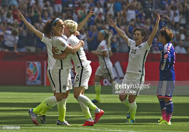 USA midfielder Lauren Holiday celebrates her goal with teammates as Japan forward Shonobu Ohno looks on during the final football match between USA...