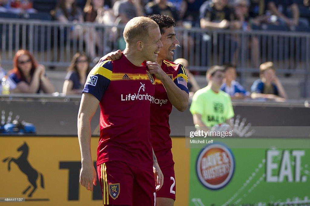 Midfielder Luke Mulholand and defenseman Tony Beltran of Real Salt Lake celebrate a goal in the first half against the Philadelphia Union on April 12...
