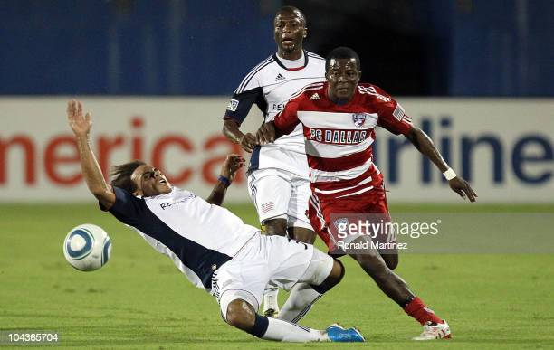 Midfielder Marvin Chavez of FC Dallas dribbles the ball past Kevin Alston of the New England Revolution at Pizza Hut Park on September 22 2010 in...