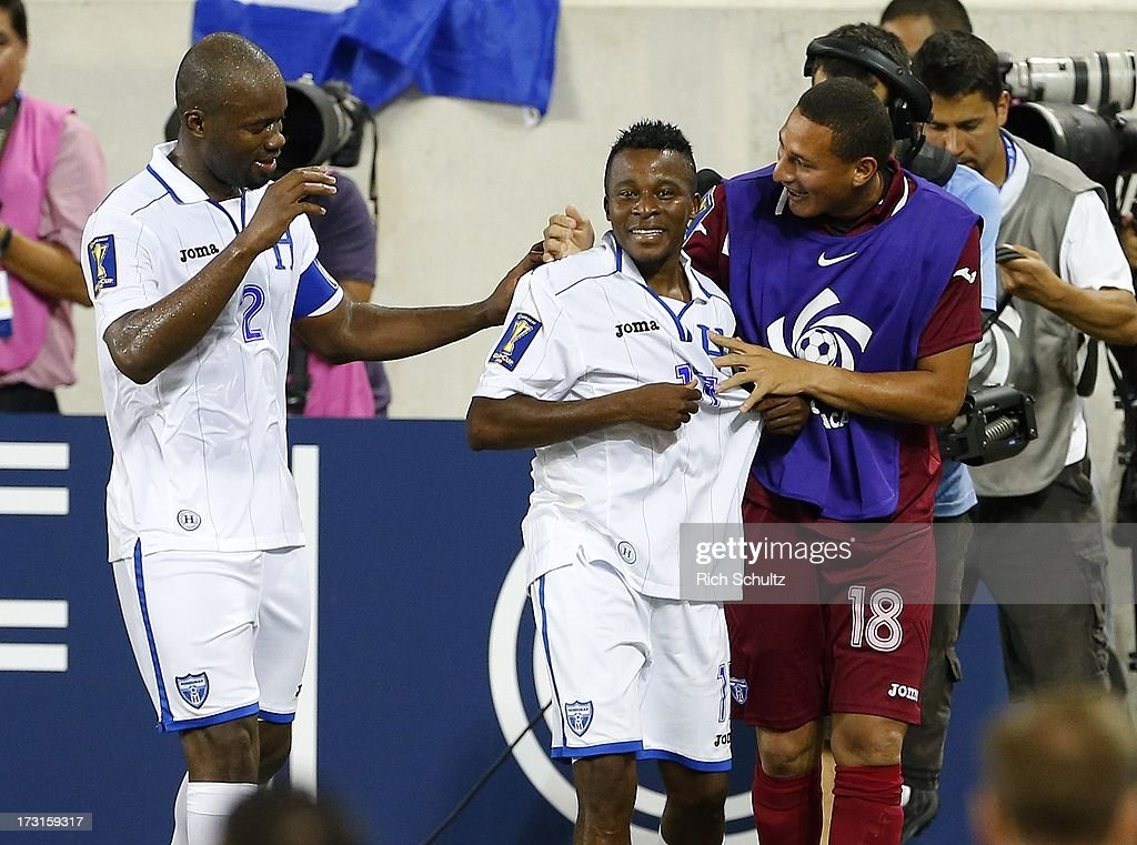 Midfielder Marvin Chavez #17 of Honduras is congratulated by teammates defender <a gi-track='captionPersonalityLinkClicked' href=/galleries/search?phrase=Osman+Chavez&family=editorial&specificpeople=4958321 ng-click='$event.stopPropagation()'>Osman Chavez</a> #2 and backup goalkeeper Kevin Hernandez #18 after he scored a goal during the second half against Haiti in a 2013 CONCACAF Gold Cup soccer match on July 8, 2013 at Red Bull Arena in Harrison, New Jersey. Honduras defeated haiti 2-0.