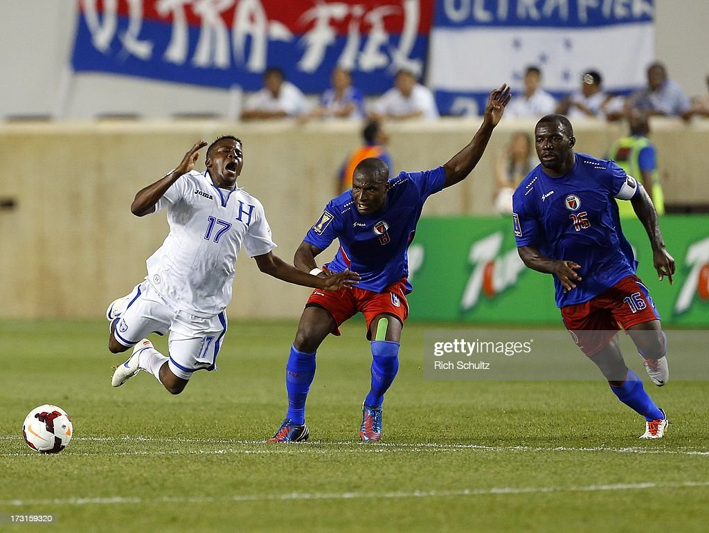 Midfielder <a gi-track='captionPersonalityLinkClicked' href=/galleries/search?phrase=Marvin+Chavez&family=editorial&specificpeople=5546152 ng-click='$event.stopPropagation()'>Marvin Chavez</a> #17 of Honduras is knocked off the ball by defender Judelin Aveska #8 and midfielder Jean-Marc Alexandre #16 of Haiti during the second half as in a 2013 CONCACAF Gold Cup soccer match on July 8, 2013 at Red Bull Arena in Harrison, New Jersey. Honduras defeated haiti 2-0.