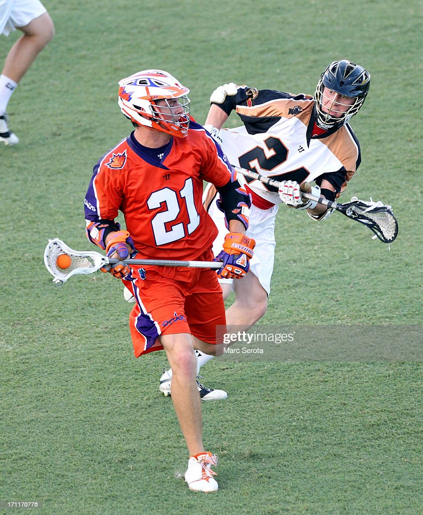 Midfielder Matt Lazore #24 of the Rochester Rattlers defends against Attacker Kevin Crowley #21 of the Hamilton Nationals during the second quarter against the Rochester Rattlers at FAU Stadium on June 22, 2013 in Boca Raton, Florida. The Nationals defeated the Rattlers 17-11.