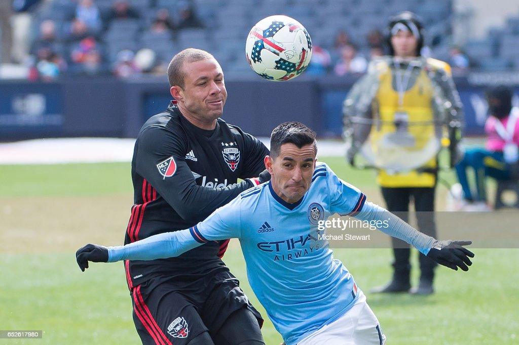 Midfielder Maximiliano Moralez #10 of New York City FC and midfielder Nick DeLeon #14 of D.C. United vie for the ball during the match at Yankee Stadium on March 12, 2017 in the Bronx borough of New York City. New York City FC deafeats D.C. United 4-0.