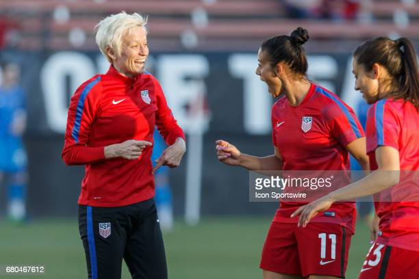 USA midfielder Megan Rapinoe and defender Ali Krieger have a laugh during warmups prior to the International Friendly match between the USA and...