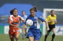 Midfielder Mia Hamm of the Washington Freedom advances the ball past defender Katie Antongiovanni of the San Jose CyberRays during the WUSA match at...