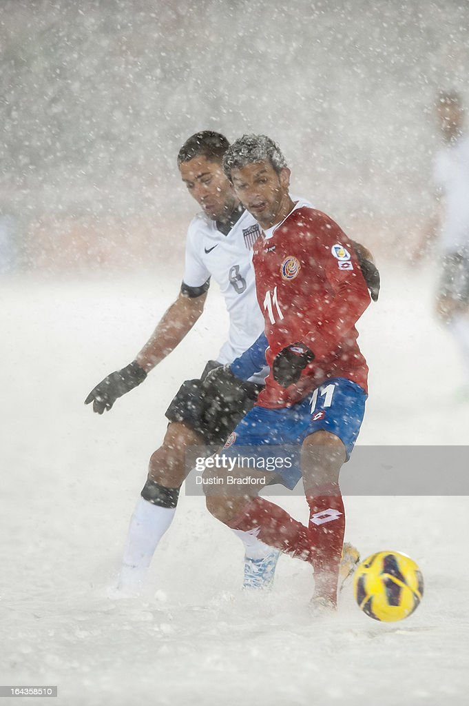 midfielder Michael Barrantes #11 of Costa Rica and midfielder <a gi-track='captionPersonalityLinkClicked' href=/galleries/search?phrase=Clint+Dempsey&family=editorial&specificpeople=547866 ng-click='$event.stopPropagation()'>Clint Dempsey</a> #8 of the United States battle for control of the ball during a FIFA 2014 World Cup Qualifier match between Costa Rica and United States at Dick's Sporting Goods Park on March 22, 2013 in Commerce City, Colorado.