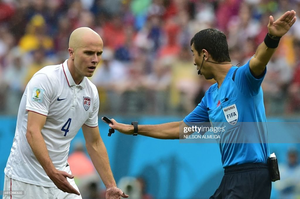 US midfielder <a gi-track='captionPersonalityLinkClicked' href=/galleries/search?phrase=Michael+Bradley+-+Soccer+Player&family=editorial&specificpeople=7022299 ng-click='$event.stopPropagation()'>Michael Bradley</a> (L) discusses with Uzbek referee Ravshan Irmatov during a Group G football match between US and Germany at the Pernambuco Arena in Recife during the 2014 FIFA World Cup on June 26, 2014.