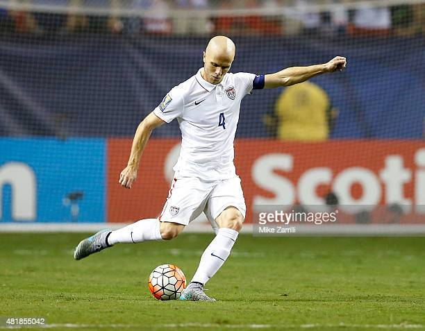 Midfielder Michael Bradley of the United States passes during the 2015 CONCACAF Gold Cup semifinal match against Jamaica at Georgia Dome on July 22...