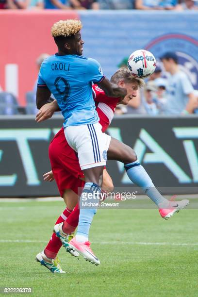 Midfielder Midfield Bastian Schweinsteiger of Chicago Fire heads the ball over forward Sean Ugo Okoli of New York City FC and during the match at...