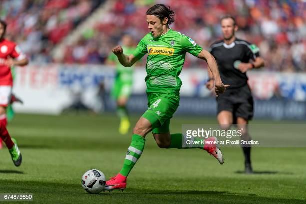 Midfielder Nico Schulz of Borussia Moenchengladbach driving the ball during the 1 Bundesliga match between 1 FSV Mainz 05 and Borussia...