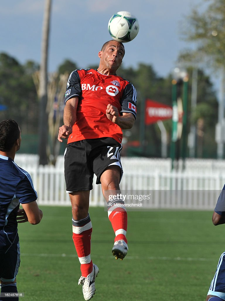 Midfielder Nik Robson #21 of Toronto FC rjumps for a ball against Sporting Kansas City in the final round of the Disney Pro Soccer Classic on February 23, 2013 at the ESPN Wide World of Sports Complex in Orlando, Florida.