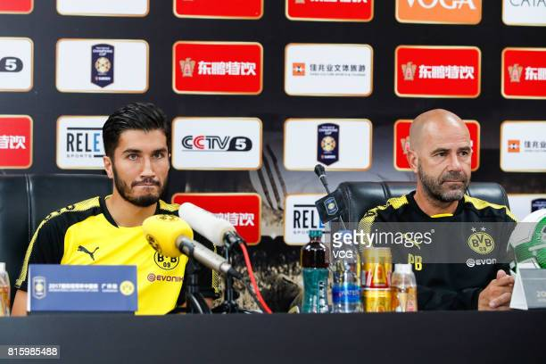 Midfielder Nuri Sahin and head coach Peter Bosz attend a press conference of Borussia Dortmund ahead of 2017 International Champions Cup China on...