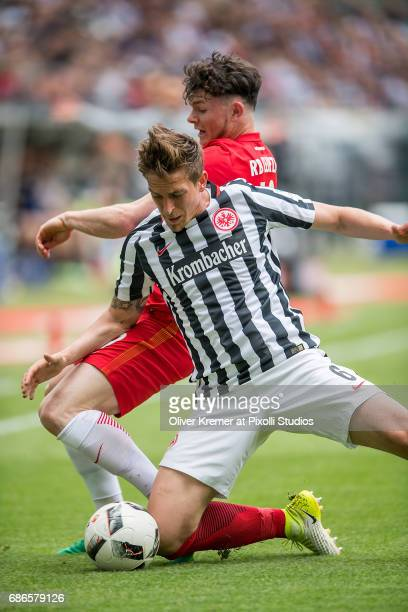 Midfielder Oliver Jasen Burke of RB Leipzig and Defense Bastian Oczipka of Eintracht Frankfurt infighting at the Commerzbank Arena during the 1...