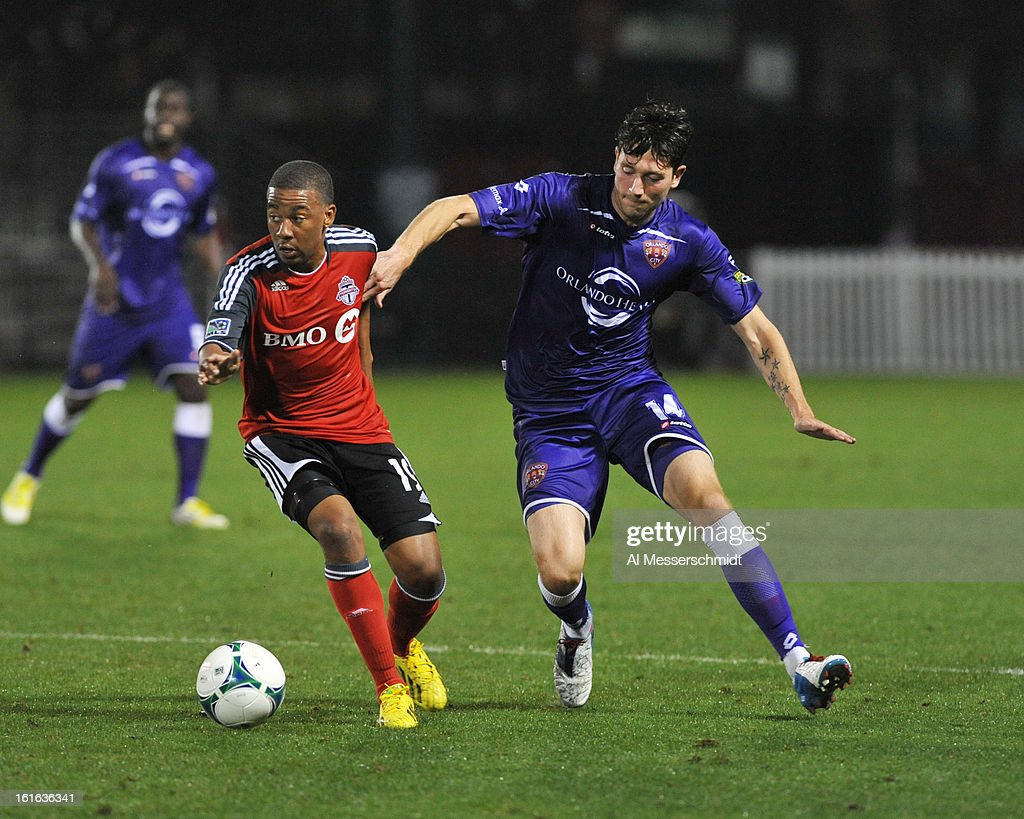 Midfielder Reggie Lambe #19 of Toronto FC battles defender Oumar Diakate #14 of Orlando City February 13, 2013 in the first round of the Disney Pro Soccer Classic in Orlando, Florida.
