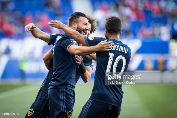 Midfielder Romain Alessandrini of the LA Galaxy celebrates his goal with teammates Giovani Dos Santos and Joao Pedro Machado during the MLS match...