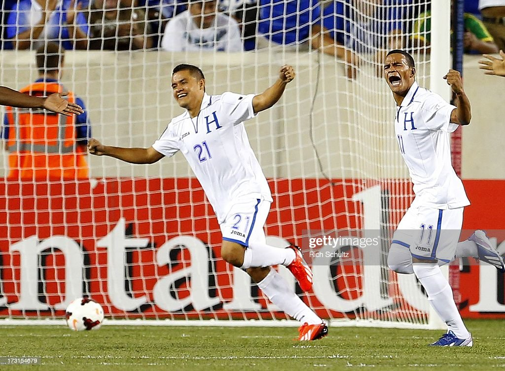 Midfielder Rony Martinez #11 of Honduras celebrates his goal with forward Roger Rojas #21 after scoring during the first half against Haiti of a 2013 CONCACAF Gold Cup soccer match on July 8, 2013 at Red Bull Arena in Harrison, New Jersey.