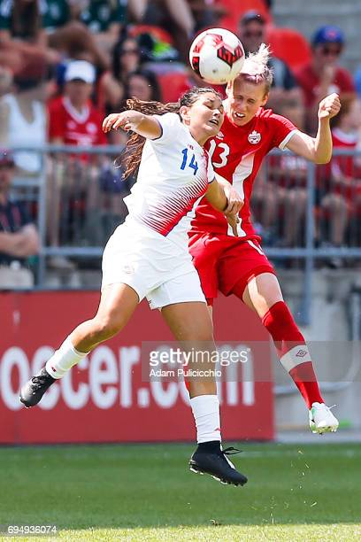 Midfielder Sophie Schmidt of Team Canada and Forward Maria Fernanda Barrantes of Team Costa Rica collide midair as they both attempt to head the ball...